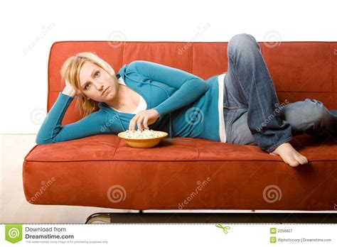 woman eats couch woman eating on couch royalty free stock photography
