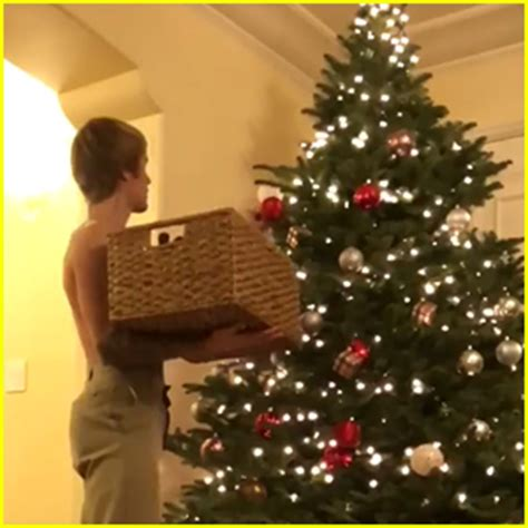 justin bieber goes shirtless while decorating his