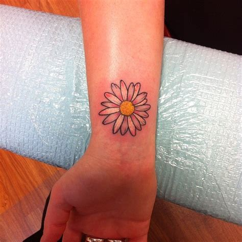 small daisy tattoo on wrist index of images 83