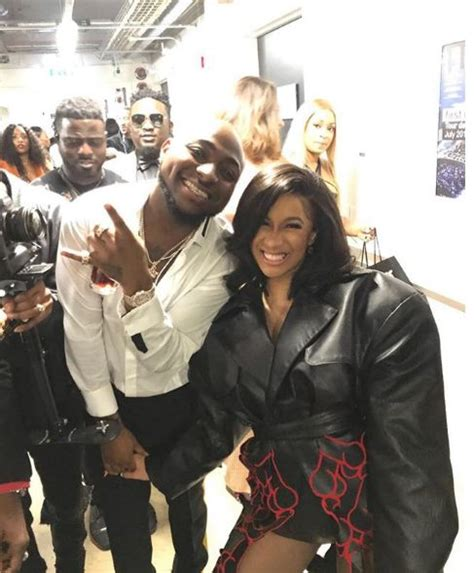 cardi b flashes fans davido meets cardi b as she flashes cleavage in fishnets