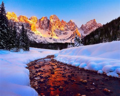 dolomites mountain peaks  italy sunrise winter snow