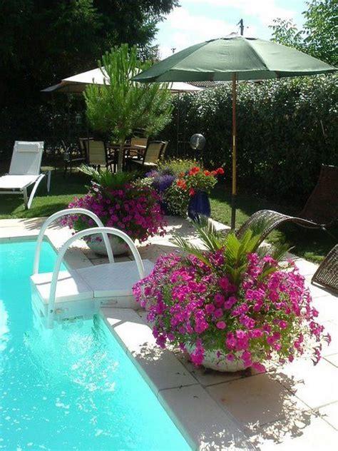 pool landscaping great idea  put umbrellas  pots