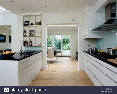 White Kitchen Cart Island Wooden Flooring In Large Modern Kitchen With Doorway To