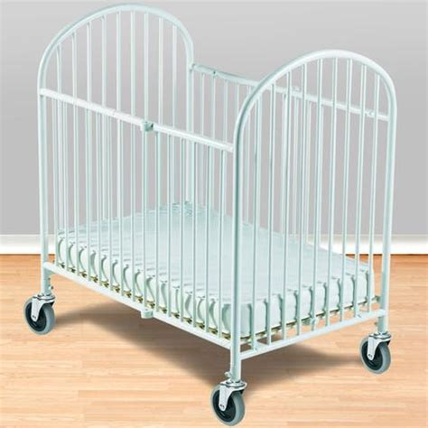 Foundations Compact Pinnacle Folding Crib W 4 Innerspring Crib Mattress