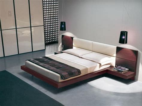 dark grey wooden bed with white leather headboard next to furniture floating black wooden flat platform bed frame