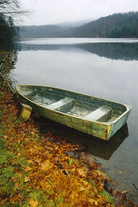 row the boat onesie an old rowboat on the shore of douthat photograph by