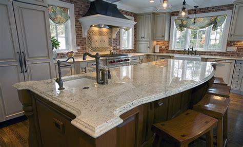 White Kitchen Cabinets With White Countertops by Bianco Romano Granite
