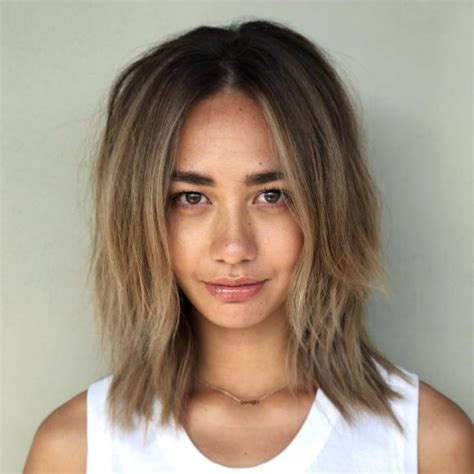 straight lob with middle part women s blunt bronze shoulder length bob with textured