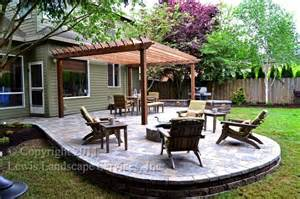 Fire Pit Under Pergola by Paver Patio Pergola Fire Pit Seat Wall Lighting