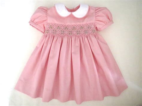 lovely light pink and white smocked dress baby