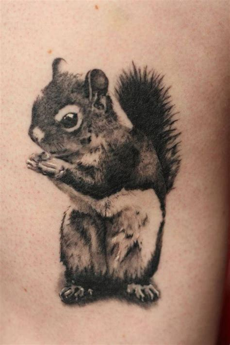 black squirrel tattoo black and grey squirrel on wrist