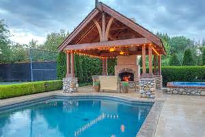 Exceptional Lounge Designs Ideas #9: Swimming-pool-gazebo-with-outdoor-fireplace-and-river-rock-pillar-design.jpg