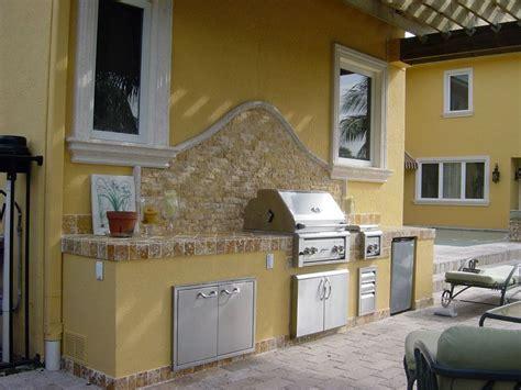outdoor kitchen backsplash ideas outdoor bbq island against house the great escape hardscape bbq kitchen bbq island bbq