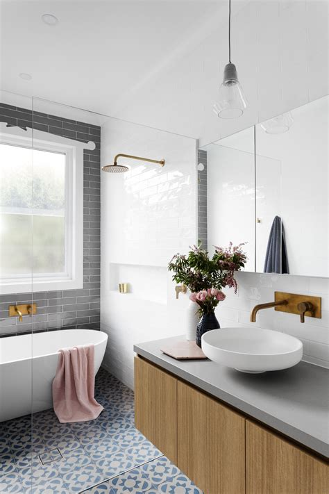 pink patterned floor tiles gray subway tiling in a serene pink white bathroom
