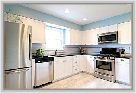 White Kitchen Cabinets With Stainless Appliances White Kitchen With Stainless Steel Appliances Black Countertops White Or Stainless Fridge White