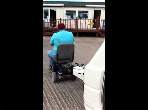 tow boat mobility scooter man uses mobility scooter to tow large boat video