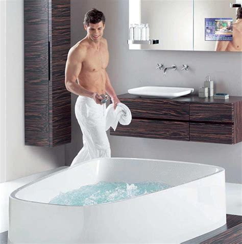 man in a bathtub hoesch singlebath bathroom suite mirror tv cabinet man