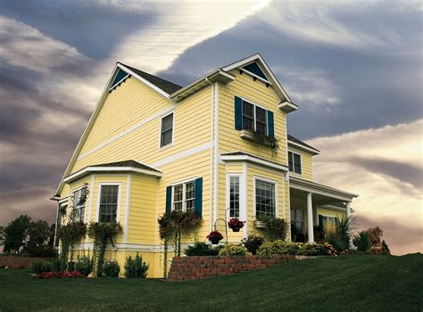 houses with yellow siding house on the hill siding exteriors room scenes