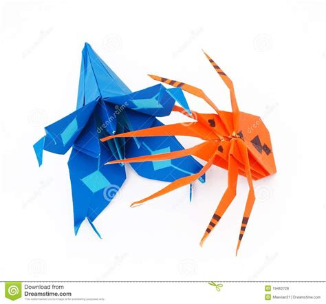 Spider Web Origami - origami spider and blue royalty free stock photos
