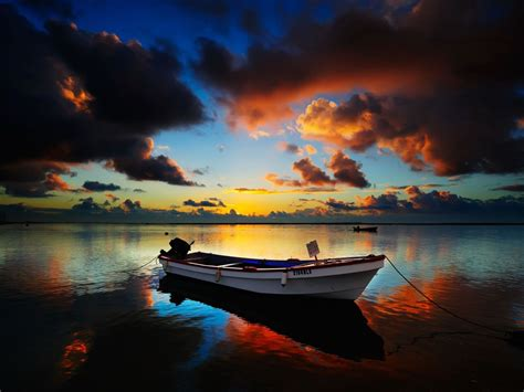 what color is peaceful peaceful sunset beautiful boat clouds colorful colors