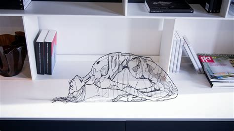 3d printing pen turns doodles into sculptures it seems like an ordinary pen at but once you start