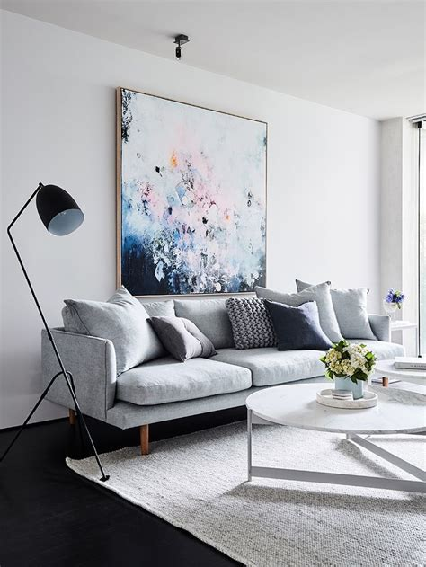 living room pale grey sofa scatter cushions pastel
