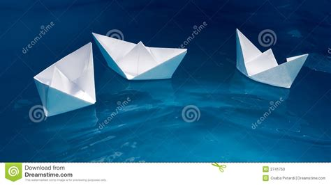 Paper Ship - paper ship floating in the sea toned photo stock photo