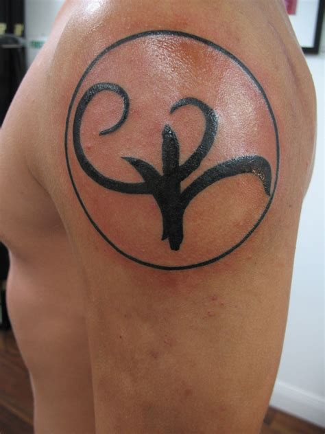 strength symbol tattoo 30 stunning strength tattoos designs echomon