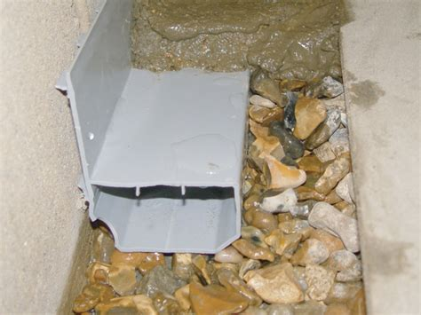 interior basement drain installation in basement