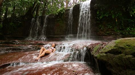 woman in the tarzan waterfall commercial sexy girl lying down in river by eldelik videohive