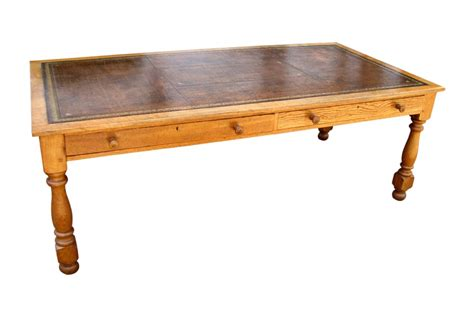 a large antique golden oak conference writing desk