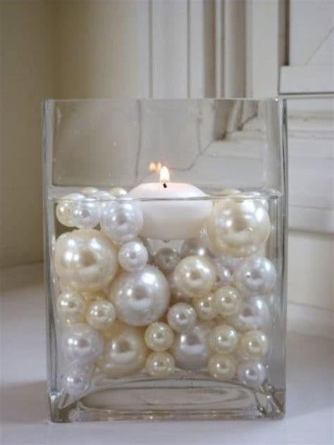 wedding centerpieces with candles and pearls large and low cylinder vase or cube filled with pearls