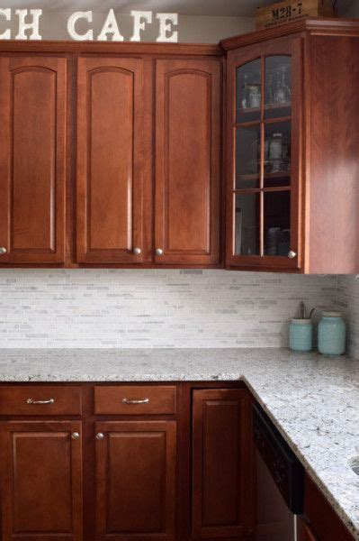 white and cherry kitchen cabinets kitchen makeover reveal cherry cabinets marble tiles