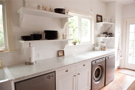 our bright white open kitchen traditional laundry