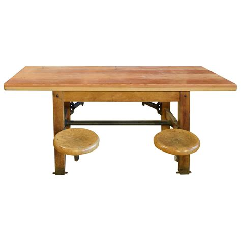 swing table table with swing arm seats at 1stdibs