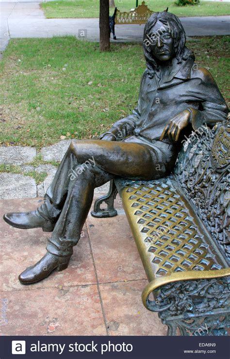 sculpture bench sculpture of john lennon sitting on a bench in john lennon
