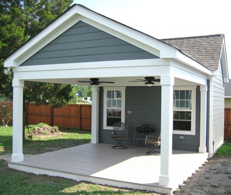 covered porch garage with porch outbuilding with covered porch
