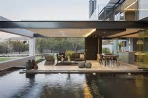 Contemporary architecture featuring glass walls and artistic abstract