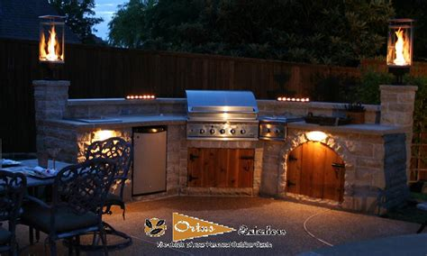 outdoor kitchen construction night lights award winning tempest torch now at flame connection
