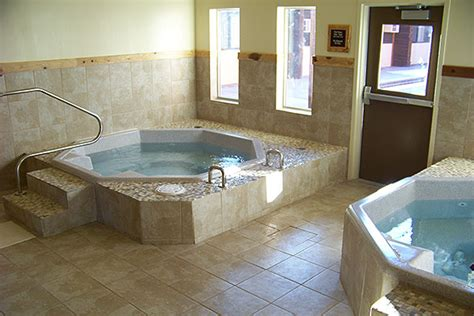 hotel rooms with bathtubs the pool hot tub and fitness center at three bear lodge