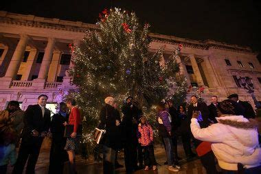 trenton tree group objects to christmas tree being cut