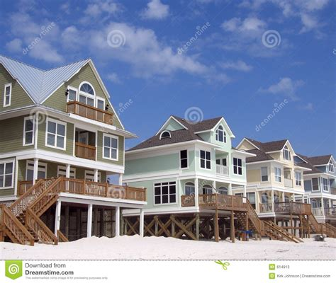 beach houses to buy beach homes on blue sky background stock photos image 614913