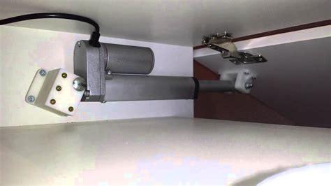 Linear Actuator Door Opener Youtube Automatic Cabinet Door Opener