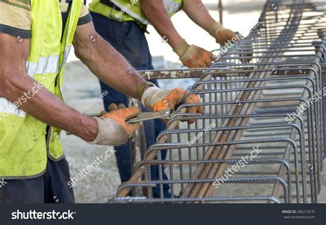 Rebar Worker by Up Of Construction Worker Working With Pincers On Fixing Steel Rebar At Building