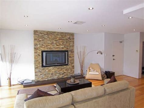 adding a stone accent wall adds so much sophistication to a home and is so easy a couple our