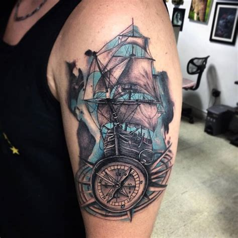 grey ink nautical compass and ship tattoo on left half sleeve