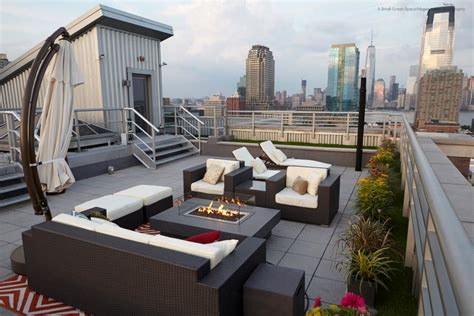 contemporary nyc rooftop deck with lawn fire pit and