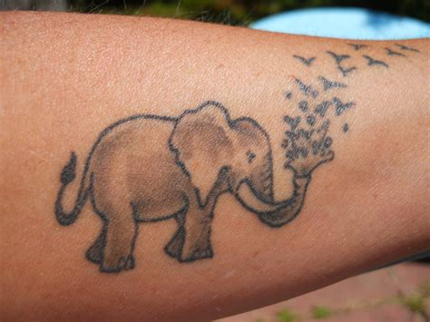 elephant tattoo with flowers elephant tattoos designs ideas and meaning tattoos for you