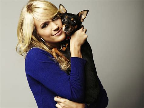 carrie underwood dogs carrie underwood s ace is doing water rehab after suffering paralyzing
