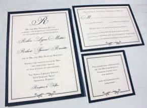 formal navy blue belly band wedding invitations with monogram thick border and swirl accent